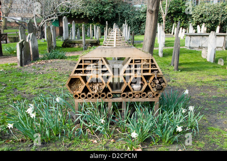 invertebrate Bug Hotel or Insect House  situated amongst gravestones, Bunhill Fields Burial Ground - Stock Photo