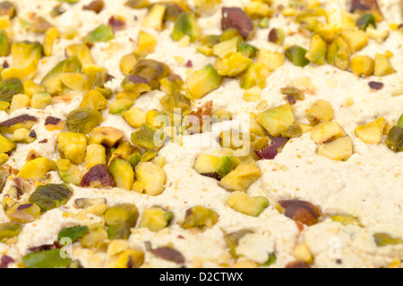 Halva with pistachios, background closeup - Stock Photo