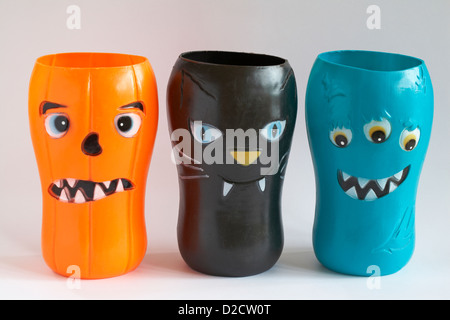scary halloween faces on plastic beakers isolated on white background - Stock Photo