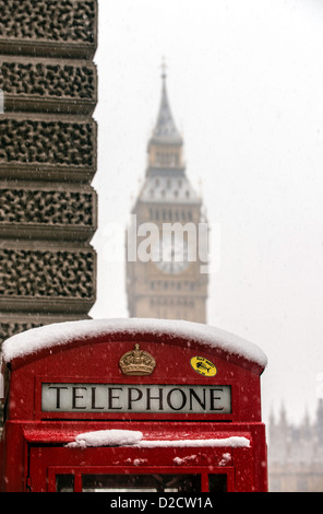 A red telephone box with the Big Ben in the background Parliament square Westminster London England Great Britain - Stock Photo