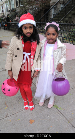 Halloween trick-or-treaters in the Kensington section of Brooklyn, NY, 2011. Costumed, Bangladeshi girls. - Stock Photo