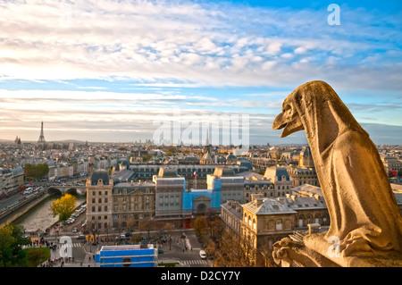 Gargoyle overlooking Paris up on Notre Dame de Paris, France - Stock Photo