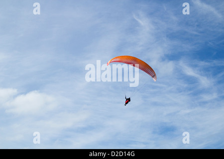 Paraglider against blue sky - Stock Photo