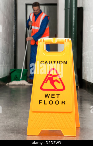 MODEL RELEASED Wet floor sign - Stock Photo