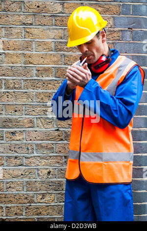 MODEL RELEASED Smoking at work - Stock Photo