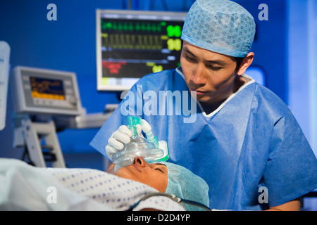 MODEL RELEASED Administering anaesthetic - Stock Photo