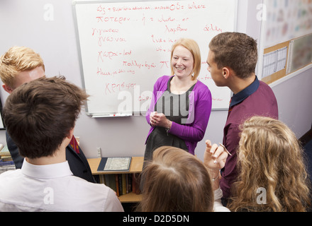 Teacher and students talking in class - Stock Photo