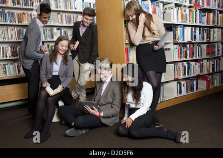 Students reading in library - Stock Photo