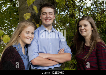 Students standing together in forest - Stock Photo