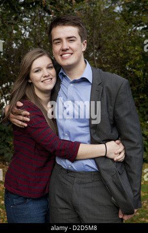 Couple standing together in park - Stock Photo