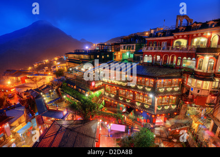Jiufen, Taiwan hillside with old teahouses at dusk. - Stock Photo