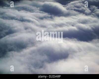 Pilots eye view above the clouds, with a light aircraft flying on an opposite course below, shot over Shropshire, - Stock Photo
