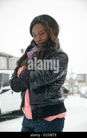 Nigerian Ebo African woman in snowing winter day - Stock Photo
