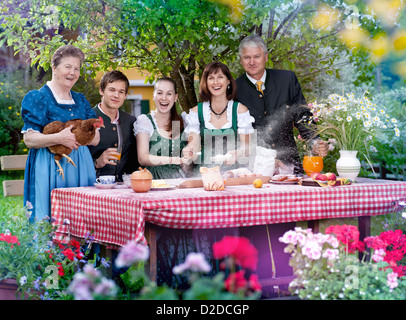 Family in traditional Bavarian clothes - Stock Photo
