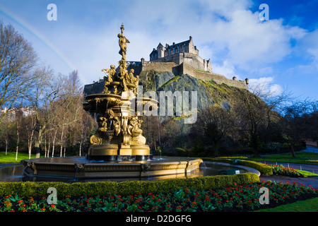 Ross Fountain in Princes Street Gardens, with Edinburgh Castle on the hill behind. - Stock Photo