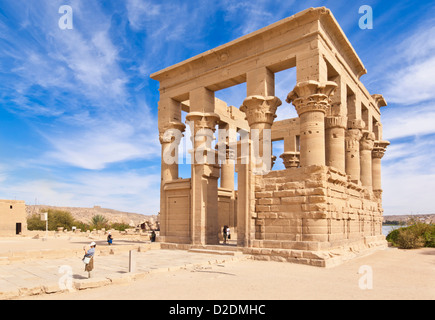tourists exploring the Kiosk of Trajan at the Temple of Isis Philae Aswan Upper Egypt Middle East - Stock Photo