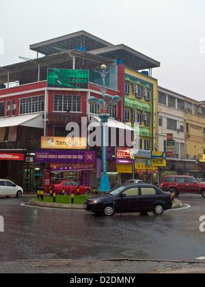 Malaysia, Borneo, Kota Kinabalu city center, Tropical rain shower - Stock Photo