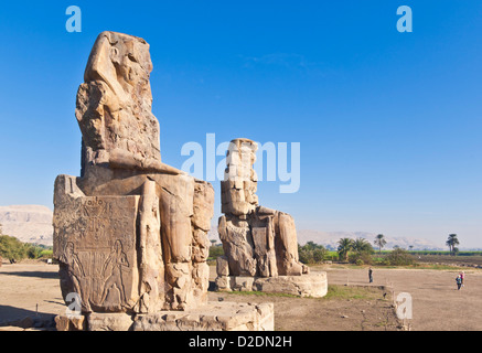two gigantic statues known as the Colossi of Memnon West bank of Luxor Egypt Middle East - Stock Photo