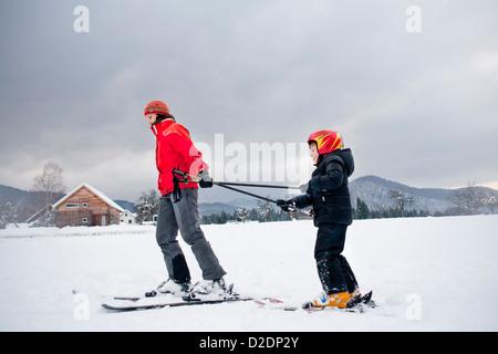 Ski lesson - family on snow. - Stock Photo