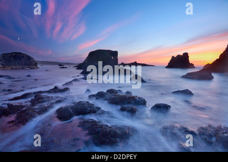 Sunset over the rocks at Whitepark Bay, Causeway Coast, County Antrim, Northern Ireland. - Stock Photo