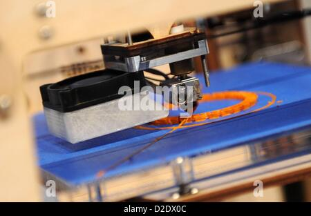 MUNICH/GERMANY - JANUARY 21:  The printing head of a 3D-printer (Ultimaker) during the Digital Life Design (DLD) - Stock Photo