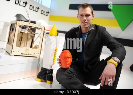 MUNICH/GERMANY - JANUARY 21:  Erik de Bruijn (Ultimaker) with his 3D-printer and 3D-printed objects during the Digital - Stock Photo