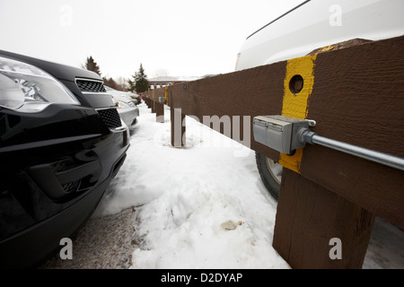 electrical power sockets in outdoor parking lot for engine block heaters saskatchewan canada - Stock Photo