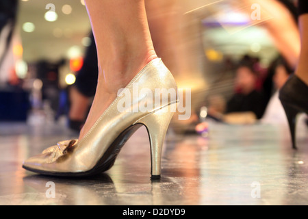 Berlin, Germany, a golden shoe at the Miss Berlin 2009/2010 - Stock Photo