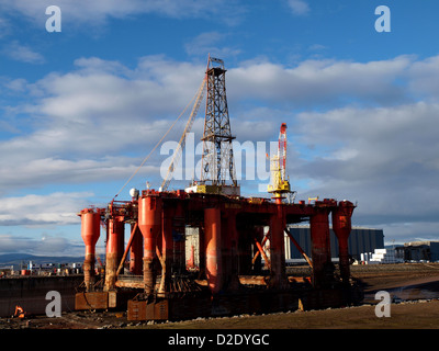 The Oil Rig Borgston Dolphin in the Dry Dock at the Nigg Energy Park, Cromarty Firth, Scotland - Stock Photo