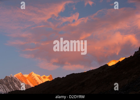 Alpenglow at sunrise on Annapurna Fang, Nepelese Himalayas. - Stock Photo