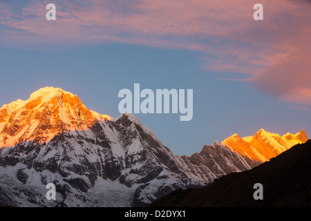 Alpenglow at sunrise on Annapurna South and Annapurna Fang, Nepelese Himalayas. - Stock Photo