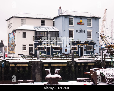 The Bridge tavern in the snow at Camber docks in Portsmouth, Hampshire - Stock Photo