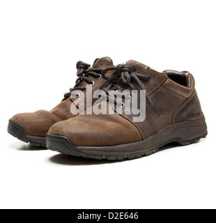 One pair of worn brown leather shoes isolated on white background - Stock Photo