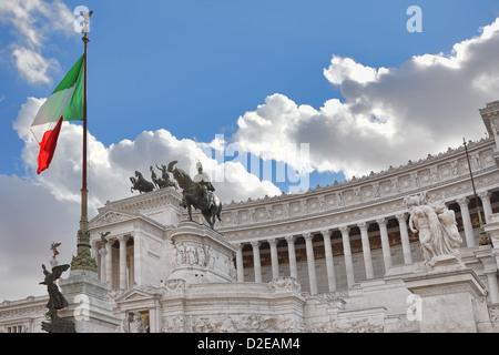 Famous Victor Emmanuel II (Vittorio Emanuele II) monument aka Altar of the Fatherland with italian national flag - Stock Photo