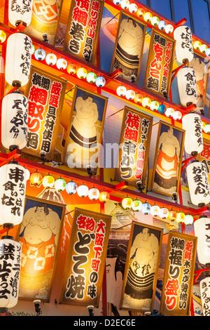 Japan, Honshu, Kansai, Osaka, Tennoji, Restaurant Facade with Lanterns and Sumo Wrestler Picture Decoration - Stock Photo
