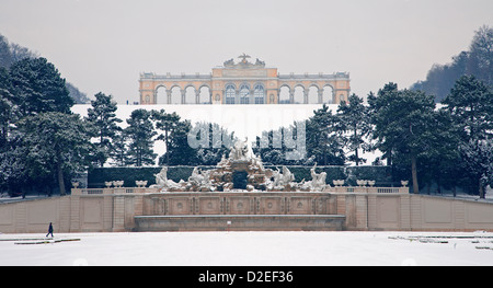 Vienna - Gloriette and Neptune fountain from Schonbrunn palace in winter - Stock Photo
