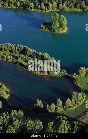 France, pond, lake with small island of green, wooded wetland along the river (aerial photo) - Stock Photo