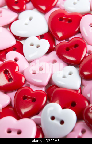 Overhead View Of Heart Shaped Buttons - Stock Photo