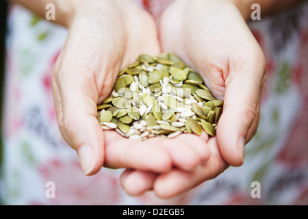 Woman Holding Handful Of Healthy Seeds - Stock Photo