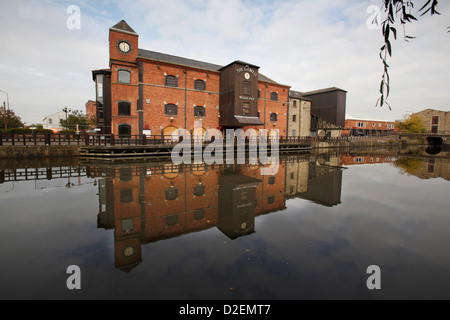The Orwell Mill reflects in the canal - Stock Photo
