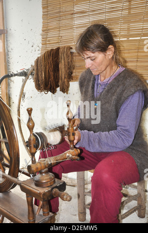 Old Fashioned manual wool spinning wheel - Stock Photo