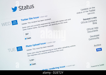 Twitter logo and status website - Stock Photo