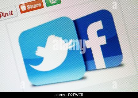 Social media logos, Twitter and Facebook close up. - Stock Photo