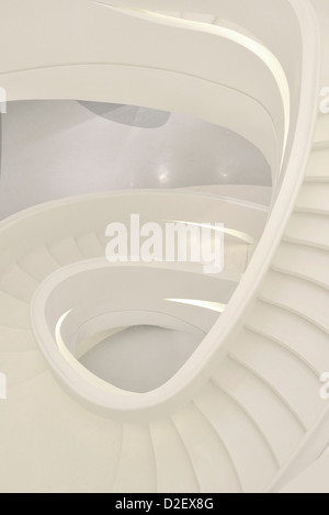 Modern and stylish curve staircase of SOHO Building in white color, Shanghai City, China. - Stock Photo