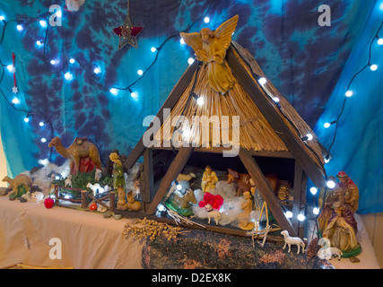 A domestic Christmas crib nativity scene with multiple characters - Stock Photo