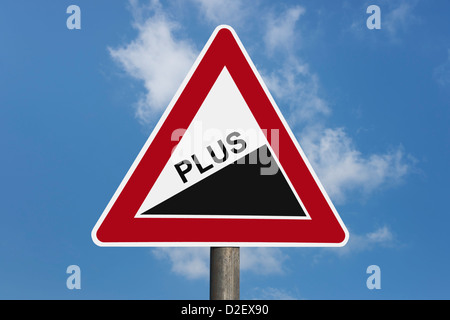 Detail photo of a danger sign 'Upward gradient' with the inscription plus - Stock Photo