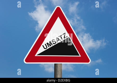 Detail photo of a danger sign 'Upward gradient' with the German inscription volume of sales - Stock Photo