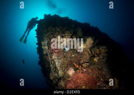 Divers on the Wreck Kyokuzan Maru Japanese freighter, sunk in 1944, Malawig Coron, Palawan, Philippines, Asia - Stock Photo