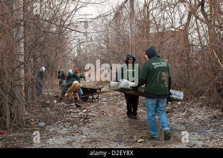 On Martin Luther King Day, college students and neighborhood residents volunteered to clean trash from vacant properties. - Stock Photo