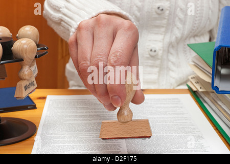 a stamp without inscription allowed is held in the hand - Stock Photo